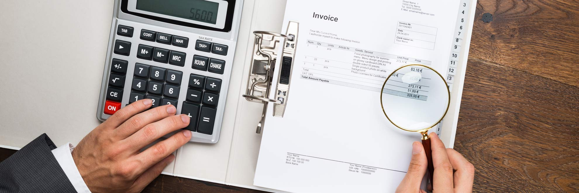 magnifying glass invoice