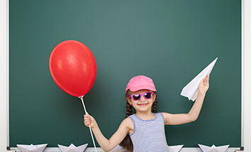 girl with paper plane and balloon